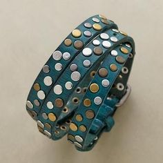 Antiqued studs light up a handcrafted leather bracelet of teal green. Wrap as you like and shine on.