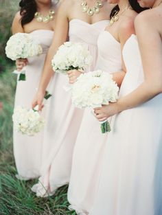 all white bouquets - Photography: Leslie-Hollingsworth.com  -- Read More: http://www.StyleMePretty.com/2014/05/28/classic-blush-colored-wedding-in-florida/