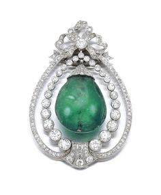EMERALD AND DIAMOND PENDANT,  CIRCA 1905.  Designed as a bow suspending a polished emerald drop, embellished with millegrain set single- and circular-cut diamonds.