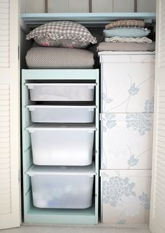 Wallpapered boxes and Ikea drawers. #storage #drawers #closet #diy #white #blue #organized #organization