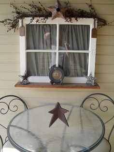my primative porch, i love old windows :)