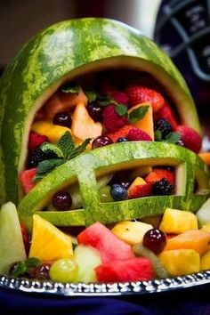 The perfect centerpiece for your Super Bowl party: a football helmet fruit salad