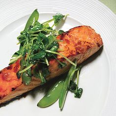 Salmon with Sweet Chili Glaze, Sugar Snap Peas, and Pea Tendrils    Read More http://www.epicurious.com/articlesguides/bestof/toprecipes/bestsalmonrecipes/recipes/food/views/Salmon-with-Sweet-Chili-Glaze-Sugar-Snap-Peas-and-Pea-Tendrils-358190#ixzz25hINHxy9