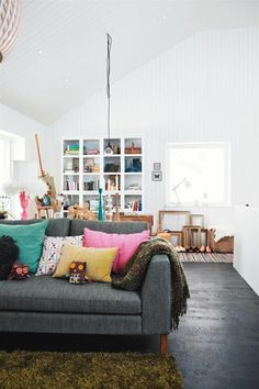 Great pops of color on a grey couch. http://obus.com.au