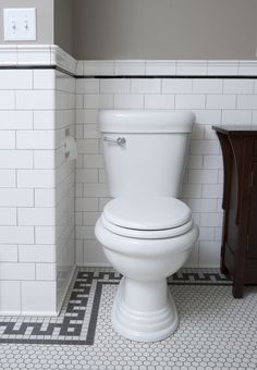 "The plain white 1"" hex-tile mosaic floor from Clay Squared to Infinity is typical of bathrooms from around 1900."
