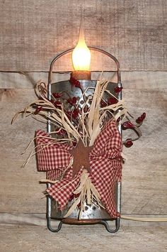 Rusty Primitive Cheese Grater Light. $12.95, via Etsy.