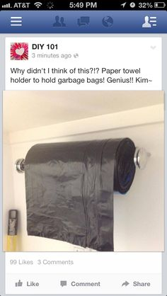 A paper towel bar to dispense trash can liners - cool. Great for your garage too.