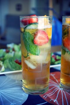 A Favorite English SummerCocktail called Pimms: fill a glass with ice, mint leaves, strawberries, orange and cucumber. Mix 1 part Pimms with 3 parts lemonade (and by lemonade I mean 7up or Sprite),  BTW: Pimm's No. 1 is a gin-based liquor made in England from dry gin, liqueur, fruit juices and spices