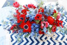 Red and blue flowers: http://www.stylemepretty.com/living/2014/05/26/nautical-baby-shower/ | Photography: Melody Melikian - http://www.melodymelikianphotoblog.com/