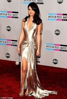 Selena Gomez - Loving this gold dress with slit goes well with her cascading waves and subtle makeup.