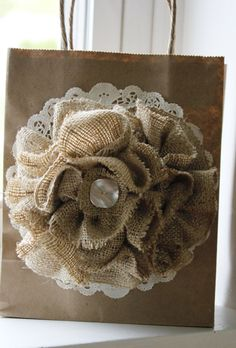 Burlap flower w/ lace & crystal (crafty project for mom?) not sure how I would use something like this, but I think mom could definitely make them! =)