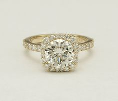 Yellow Gold Custom diamond engagement ring. Ah! Yellow gold but white gold prongs around the diamonds! Stops discoloration or darkening of the diamond. Much more radiant