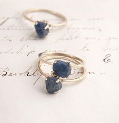 ((about)) These indigo-colored sapphires are in their natural state, unpolished and irregularly shaped. We've carefully hand-set each one in a gold mounting. Yours will look similar to (but not exactl