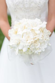 White Wedding Bouquet - LOVE. See the wedding on Style Me Pretty: http://www.StyleMePretty.com/midwest-weddings/2014/03/07/irish-barn-glam-wedding-at-whistling-straits/ Heather Cook Elliott Photography