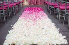 Gorgeous wedding ceremony aisle decor in white with pink ombre petals.