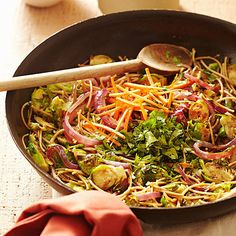 Brussels sprouts give this noodle stir fry a healthy twist. See more healthy side dish recipes: http://www.bhg.com/recipes/healthy/dinner/healthy-green-side-dishes/?socsrc=bhgpin030113brusselsstirfry=11