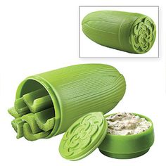 CELERY AND DIP HOLDER  Lets you enjoy healthy snacks on the go! Celery-shaped container has two separate compartments: one to hold single servings of baby carrots or celery sticks, the other for dip or condiments. Pop-open airtight lid keeps veggies and dip cool and fresh; holder prevents crushing, too.
