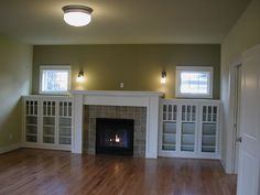 fire place and built-in shelves - great for a den - maybe a little smaller
