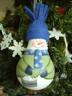 Snowman with bucket of snowballs lightbulb ornie