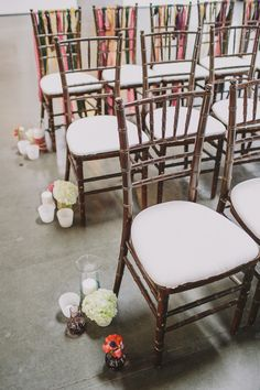 groupings of decor to line the aisle, photo by @Emily @ Anna Delores Photography http://ruffledblog.com/california-art-gallery-wedding #ceremony #details #wedding