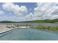 An infinity pool that overlooks the riverfront. Deep River, CT Coldwell Banker Residential Brokerage