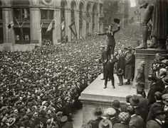 Charlie Chaplin waves to a crowd, 1918.
