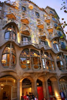 Casa Batlló is a building restored by Antoni Gaudí in 1904-1906. The building looks very remarkable — like everything Gaudí designed. The local name for the building is Casa dels ossos (House of Bones). Much of the façade is decorated with a mosaic made of broken ceramic tiles (trencadís) that starts in shades of golden orange moving into greenish blues.