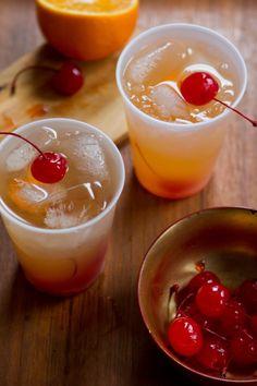 The Hurricane: White Rum, Dark Rum, Passion Fruit Juice, Orange Juice, Lime Juice, Grenadine...
