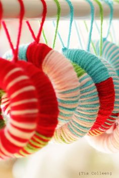 handmade yarn wreath ornaments. fun craft for kids too. and sending handmade ornaments as meaningful gifts each year? LOVE that idea. // christopher & tia
