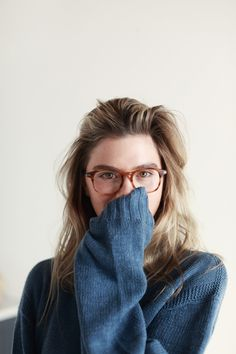 baggy sweater + frames.