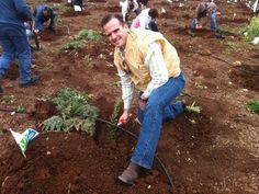 Pastor Matthew Hagee planting a tree in Israel
