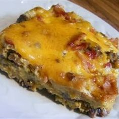 Christmas Breakfast Sausage Casserole ~ My mom has always made this for us on Christmas morning, and since we only have it once a year it makes it even more good. It is so delicious, and everyone enjoys it! When I double the recipe I use 1 pound regular sausage and 1 pound sage sausage,