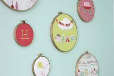 Embroidery hoops spray-painted gold with fun fabrics are great wall decor for the baby's room!