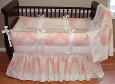 Ciara Baby Bedding  THIS BEDDING WILL NOT BE MADE WITH THIS EXACT DAMASK PRINT.. If you order this set it will be made in just the same style but with a different pink and white large damask print.  Included in this set is the bumper, blanket, and crib skirt.  There is lots of detail in this custom set including soft White minky, white grosgrain ties, and pink and white damask cotton.