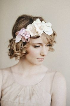 short with curls, side swept bangs and large floral head band - very vintage looking - diy hair style