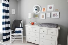 Polished #babyboy #nursery - love the navy and gray with pops of orange!