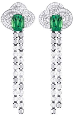 Louis Vuitton 'Voyage dans le temps' Fleur d'éternité earrings and the central tourmaline surrounded by a spiralling pattern of diamonds.      Via The Jewellery Editor.