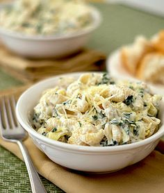 Spinach Artichoke Dip Pasta - bowl of pasta with a thick creamy sauce with plenty of tangy artichoke and earthy spinach flavor and less of the guilt