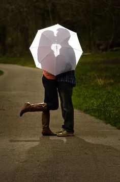 "I haven't seen this done with a shadow. This is way more cute than the average ""umbrella pic"""