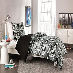 It is easy to hide under the covers with the Derek Comforter Set. Adorned with a bold camouflage print in hues of black, grey, and white, the military-themed bedding is a fun addition to any room.