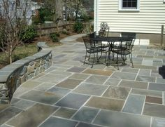 Flagstone patio with building stone seating wall in Falls Church, Va.