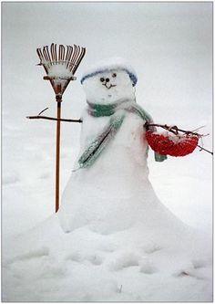 A Snowman With A Rake