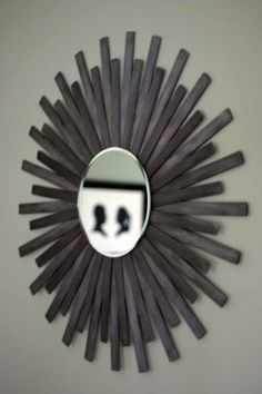 DIY sunburst mirror using paint sticks & a mirror