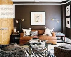 Gorgeous room. Dark walls. Wooden panels, Leather sofa. Matching cozy chairs.