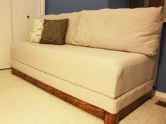 I'm digging this and many other DIY convertible couch project, but why can't I find any with arm rests?  I'll have to think of something clever to get around that.