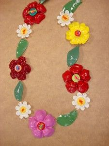 flowers made using bottoms of plastic water bottles and cut plastic caps. add paint and wahlaa