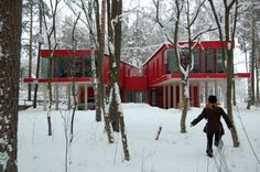 Latvia red house in snowy woodland garden NRJA l Gardenista