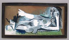 Lying female nude playing with cat - Pablo Picasso 1964