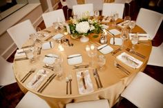 white-centerpieces-gold-linens