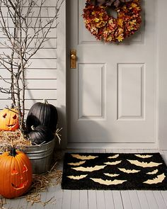 Add a festive touch to your doorway with our bats doormat and Harvest Maple Leaf Wreath.